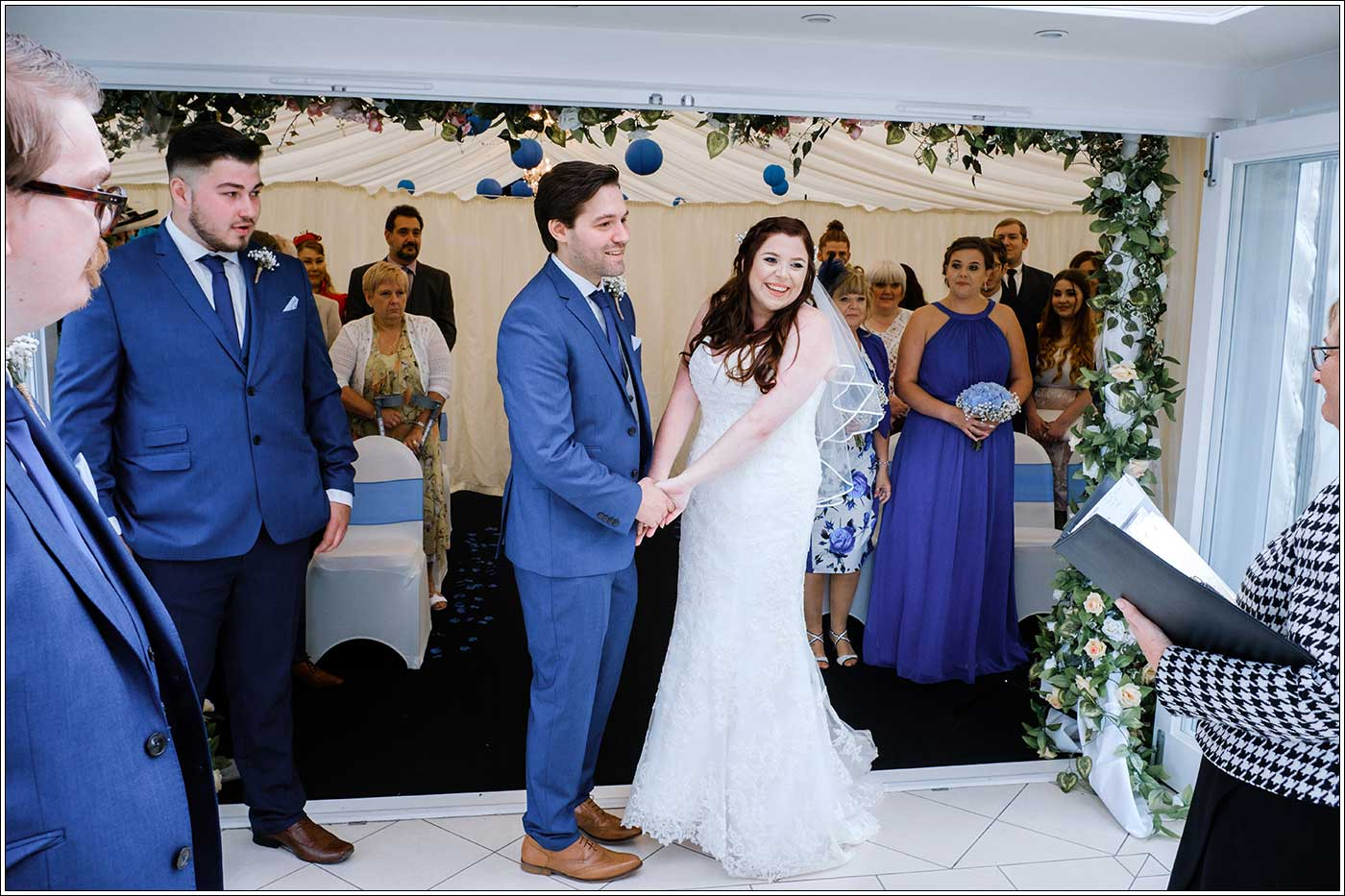 Bride and groom during their wedding ceremony at Park Hall Farm