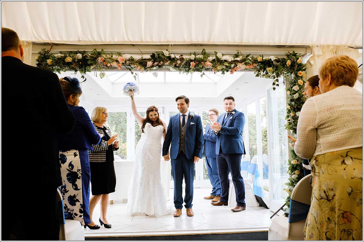 Jubilant bride walking down their aisle