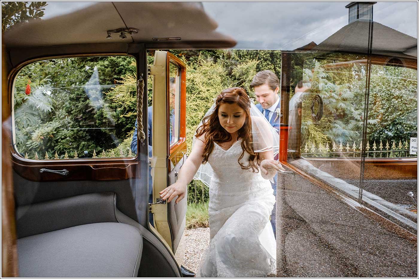Bride entering bridal car