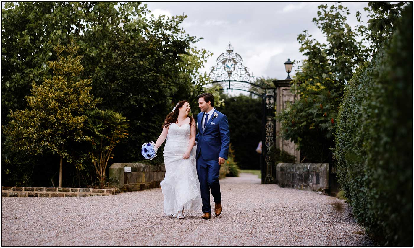 Bride and groom walking into Park Hall Farm