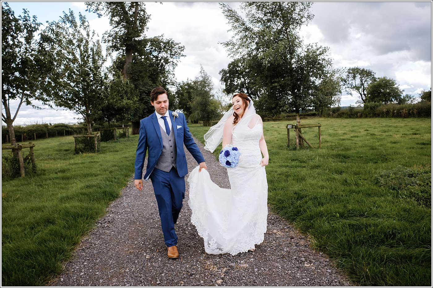 Happy bride walking with her groom at Park Hall Farm