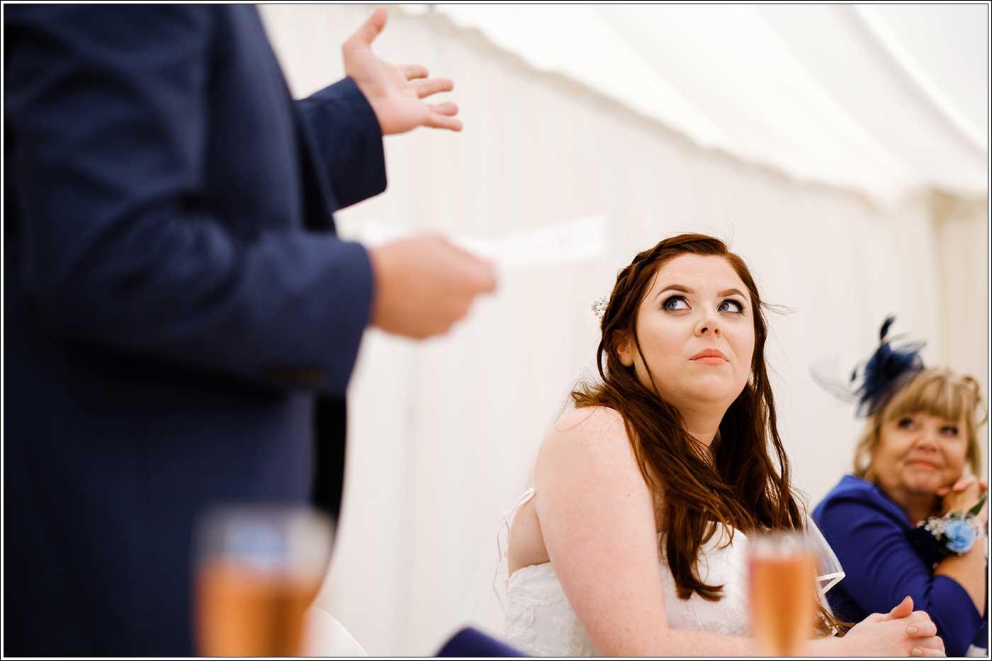 Bride listening to groom's speech