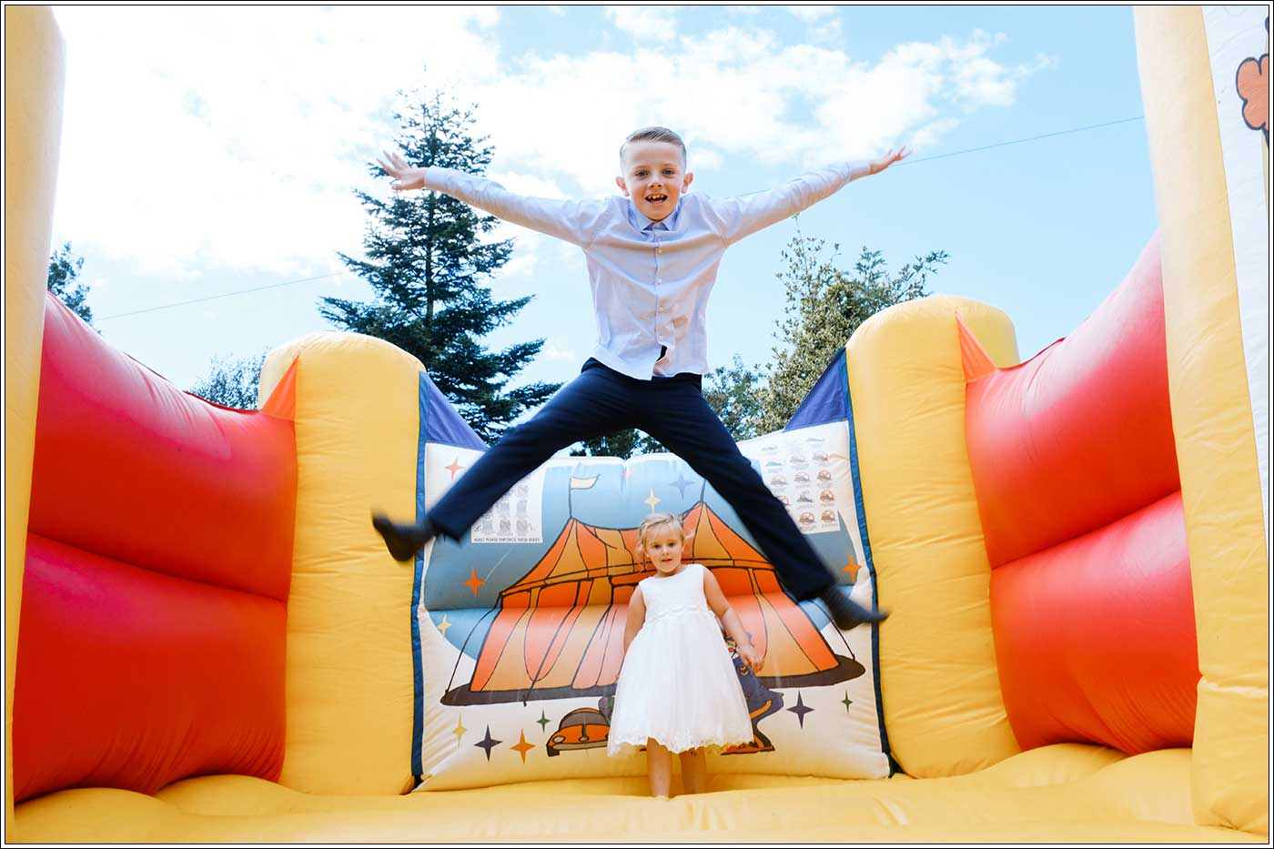 Children playing on bouncy castle at Park Hall Farm