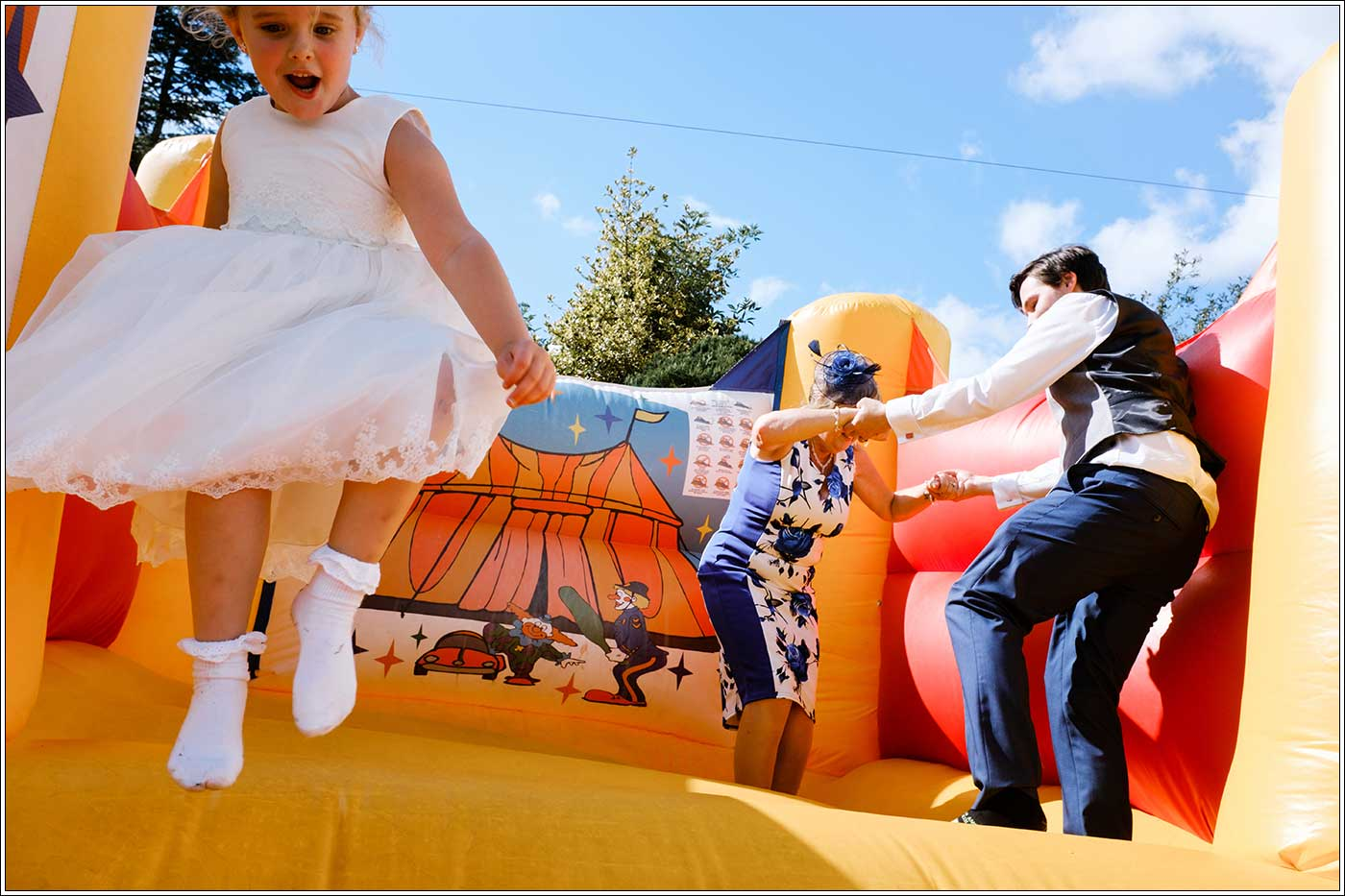 Groom and mother-in-law on bouncy castle after his Park Hall Farm wedding