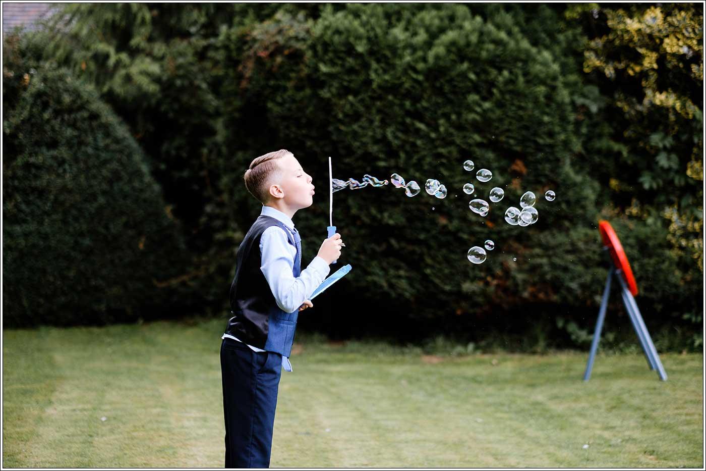 Boy blowing bubbles at Park Hall Farm