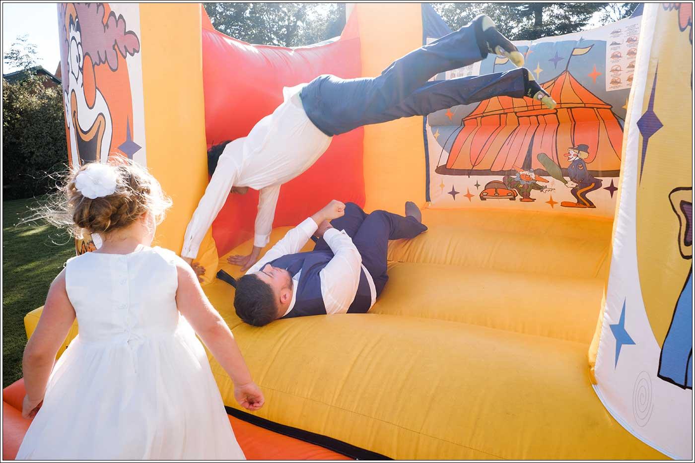 Groom and bestman on bouncy castle after a Park Hall Farm wedding