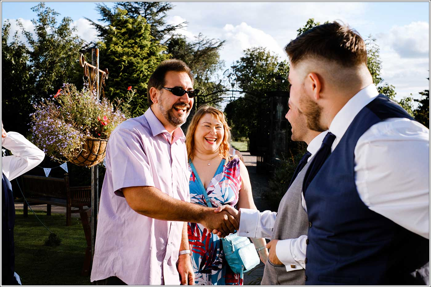 Evening wedding guest arriving at Park Hall Farm