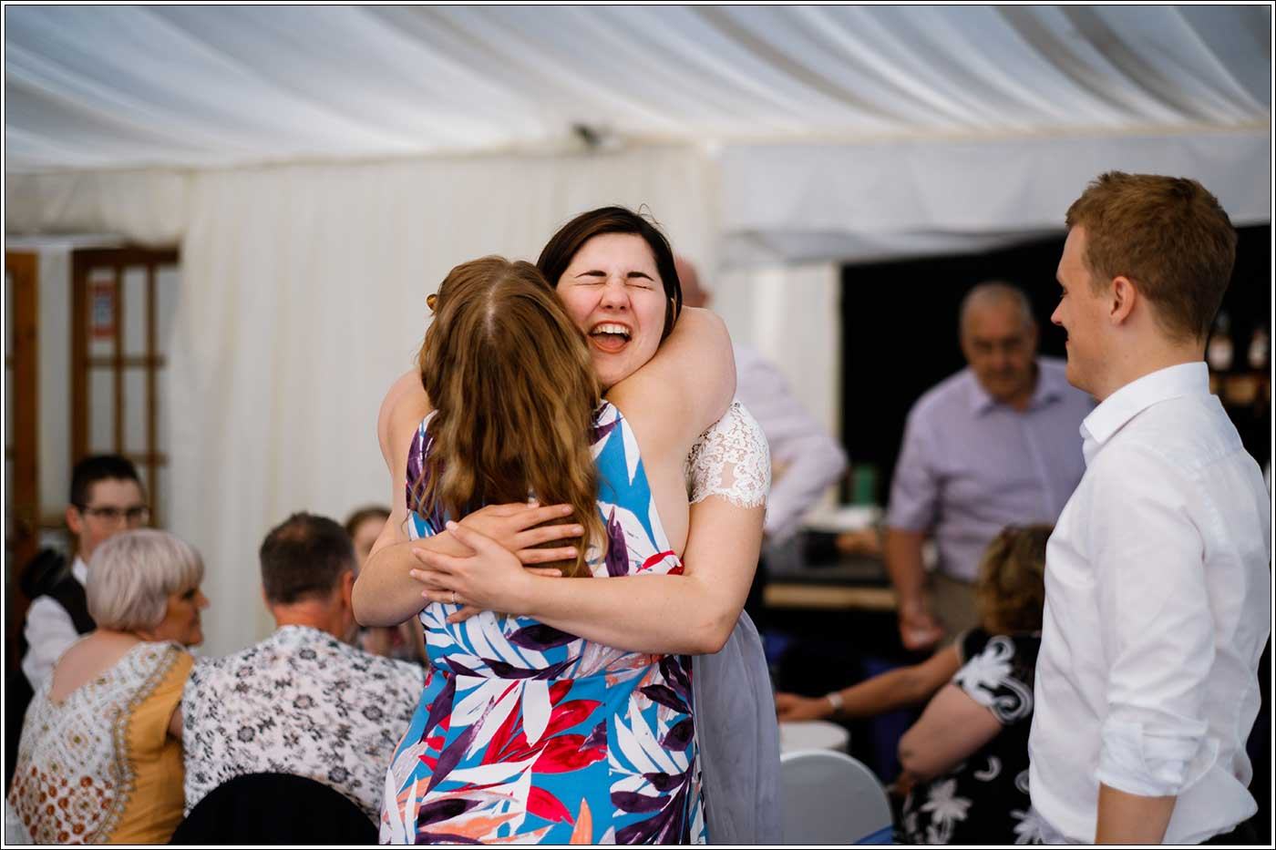 Woman being hugged during a Park Hall Farm wedding