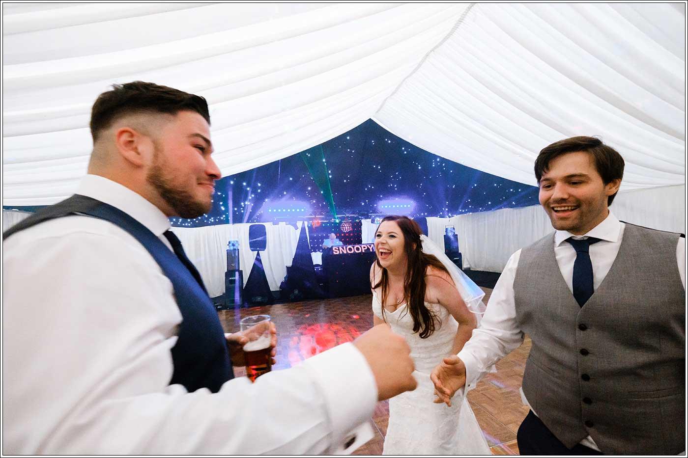 aughing bride on dancefloor