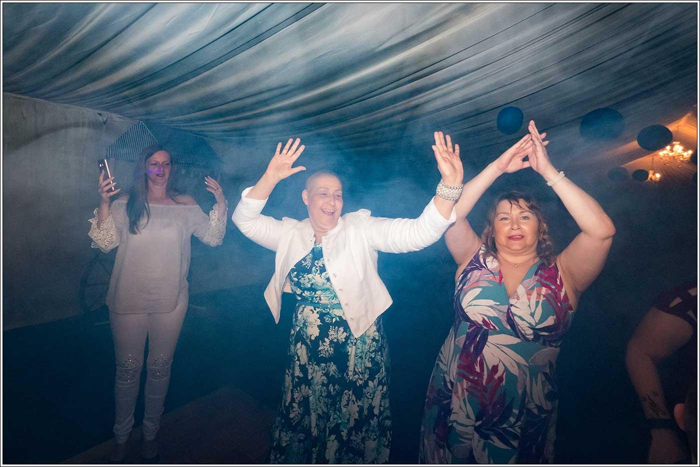 Women dancing during a Park Hall Farm wedding celebration
