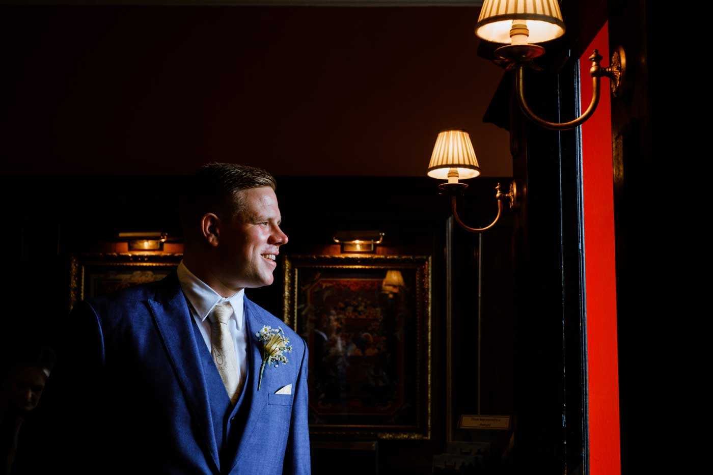 Groom in foyer of Rowton Castle before hsi wedding ceremony by Rowton Castle wedding photographer Clive Blair Photography