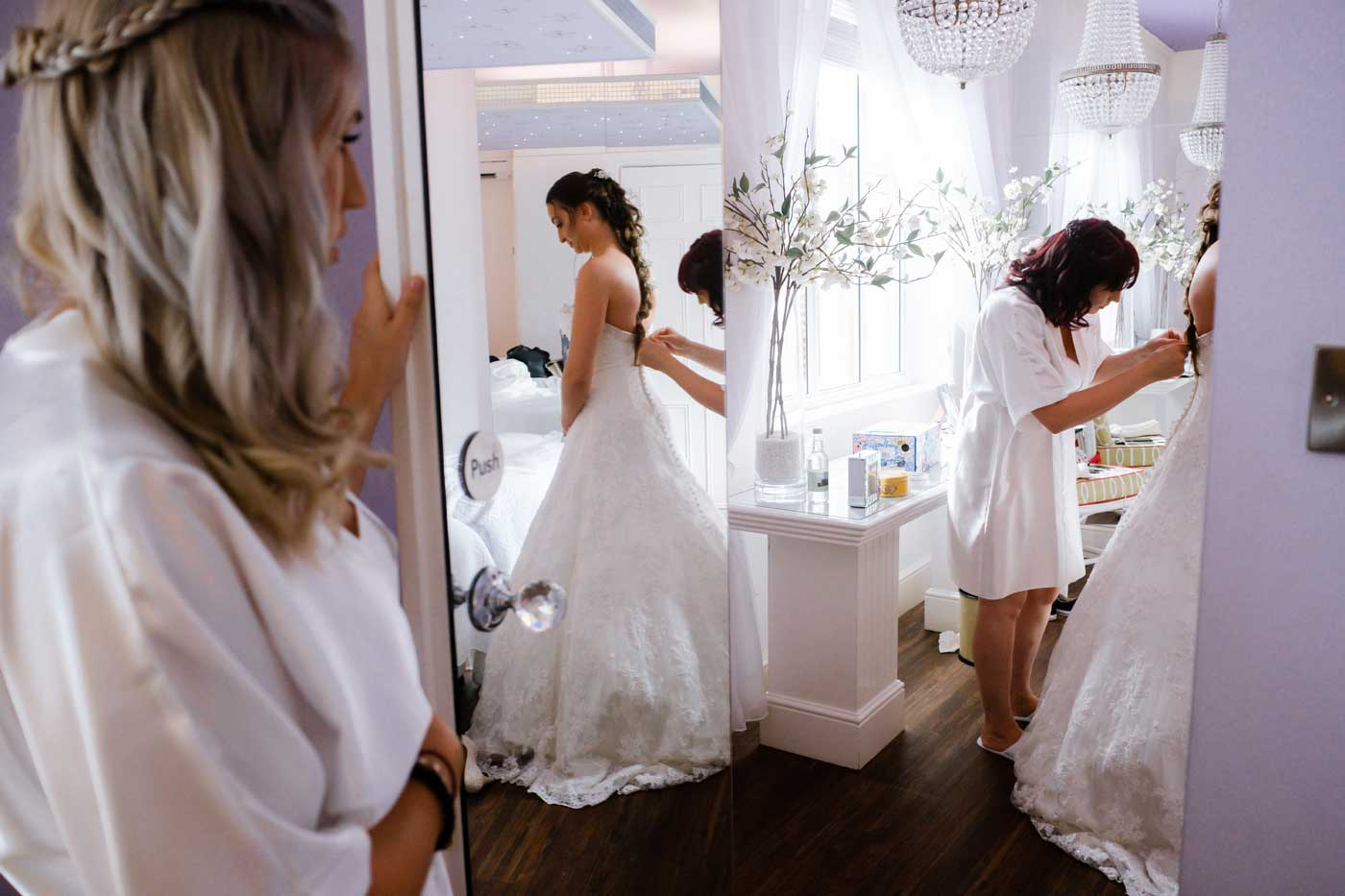Bride in reflection of mirror while getting ready in The Orchard Suite at Rowton Castle