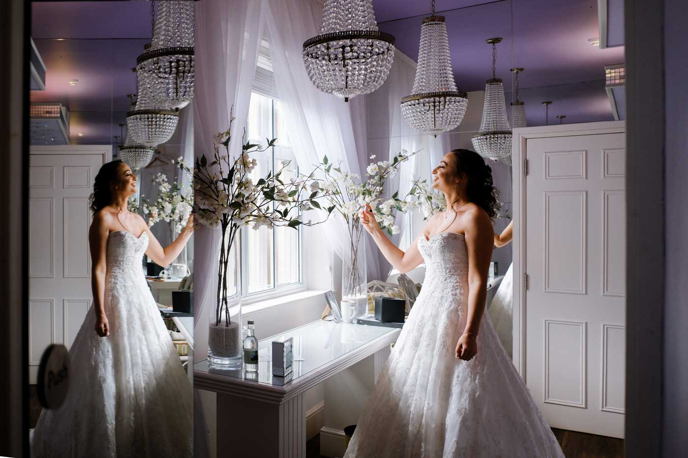 Bride putting on her perfume in The Orchard Suite before her Rowton Castle wedding ceremony
