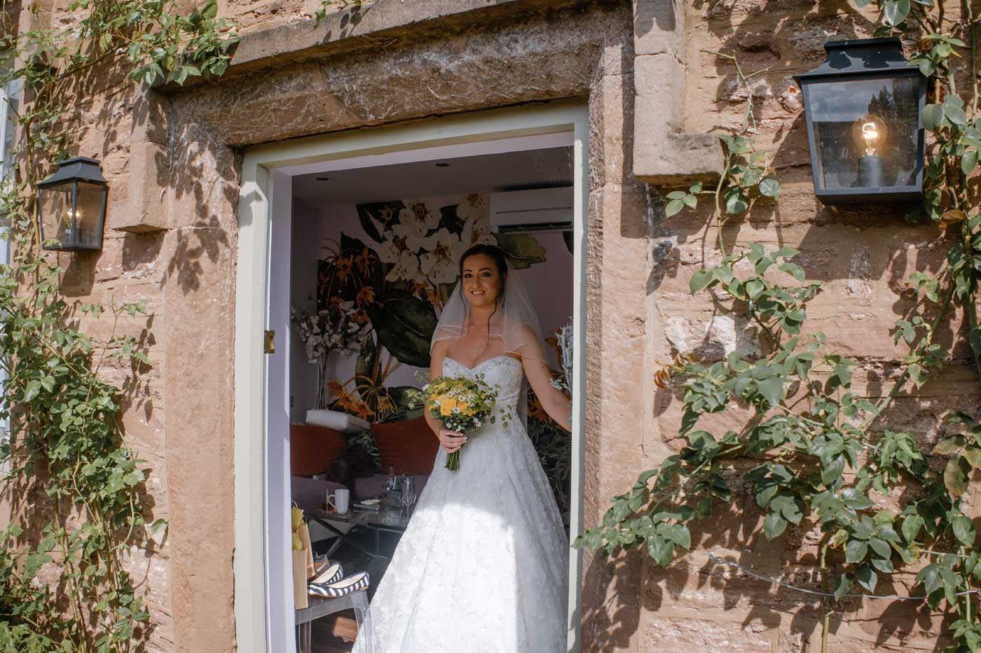 Bride leaving for her wedding ceremony at Rowton Castle by Rowton Castlewedding photographer Clive Blair Photography