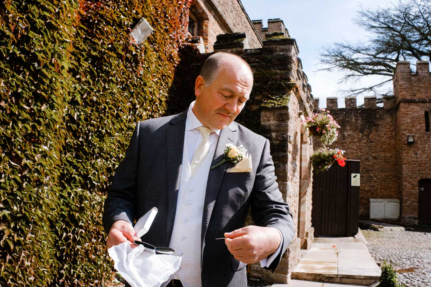 Bride's father reading the engraved plaque given him by his daughter before her Rowton Castle wedding