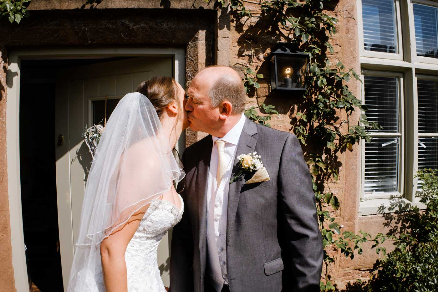 Father kissing his daughter before her Rowton Castle wedding