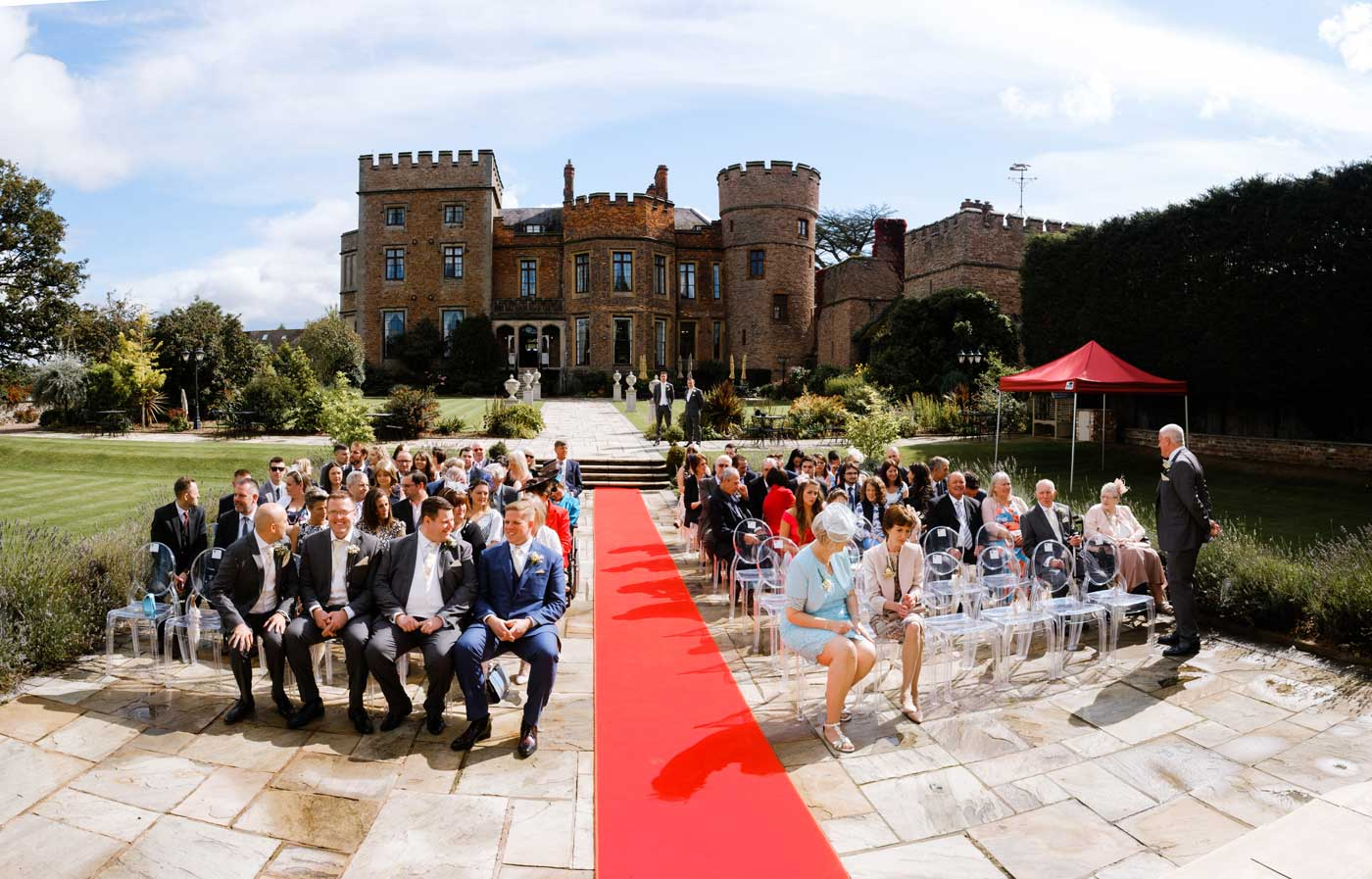 Guests waiting for the bride's arrival by Rowton Castle wedding photographer Clive Blair Photography