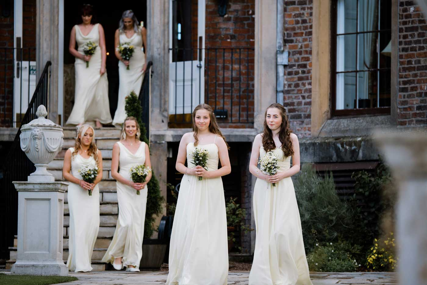 Maids arriving for the outdoor wedding ceremony at The Linden Belvedere at Rowton Castle by Rowton Castle wedding photographer Clive Blair