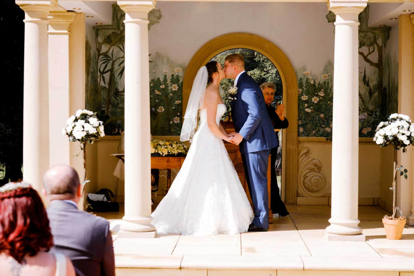 Bride and groom kissing after their Rowton Castle outdoor wedding ceremony