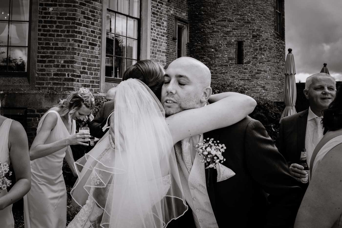 Guest hugging bride after her Rowton Castle wedding
