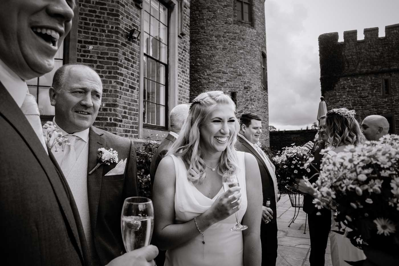 Happy guests at a Rowton Castle wedding drinks reception