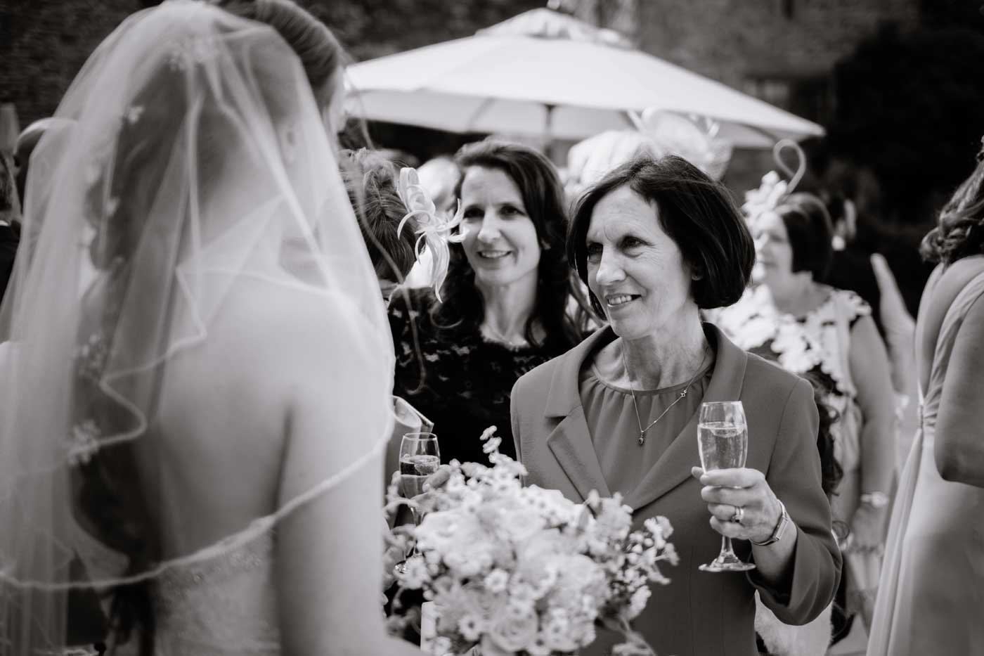 Guests greeting bride after her Rowton Castle wedding by Rowton Castle wedding photographer Clive Blair Photography