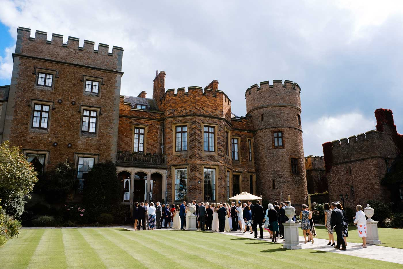 Guests during a drinks reception after a Rowton Castle wedding