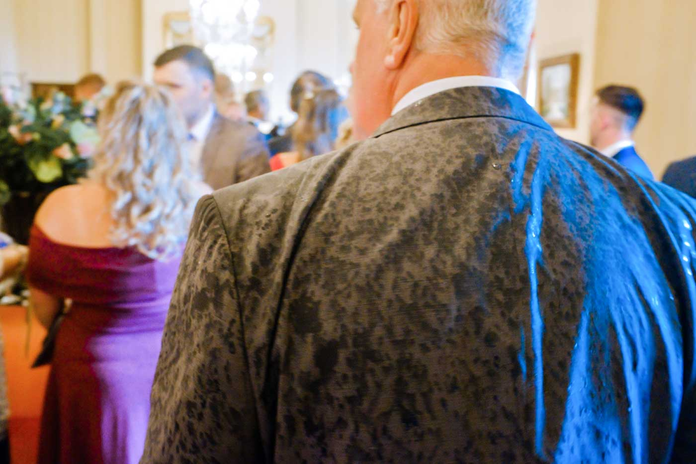 Rain soaked jacket after a sudden downpour of rain at a Rowton Castle wedding