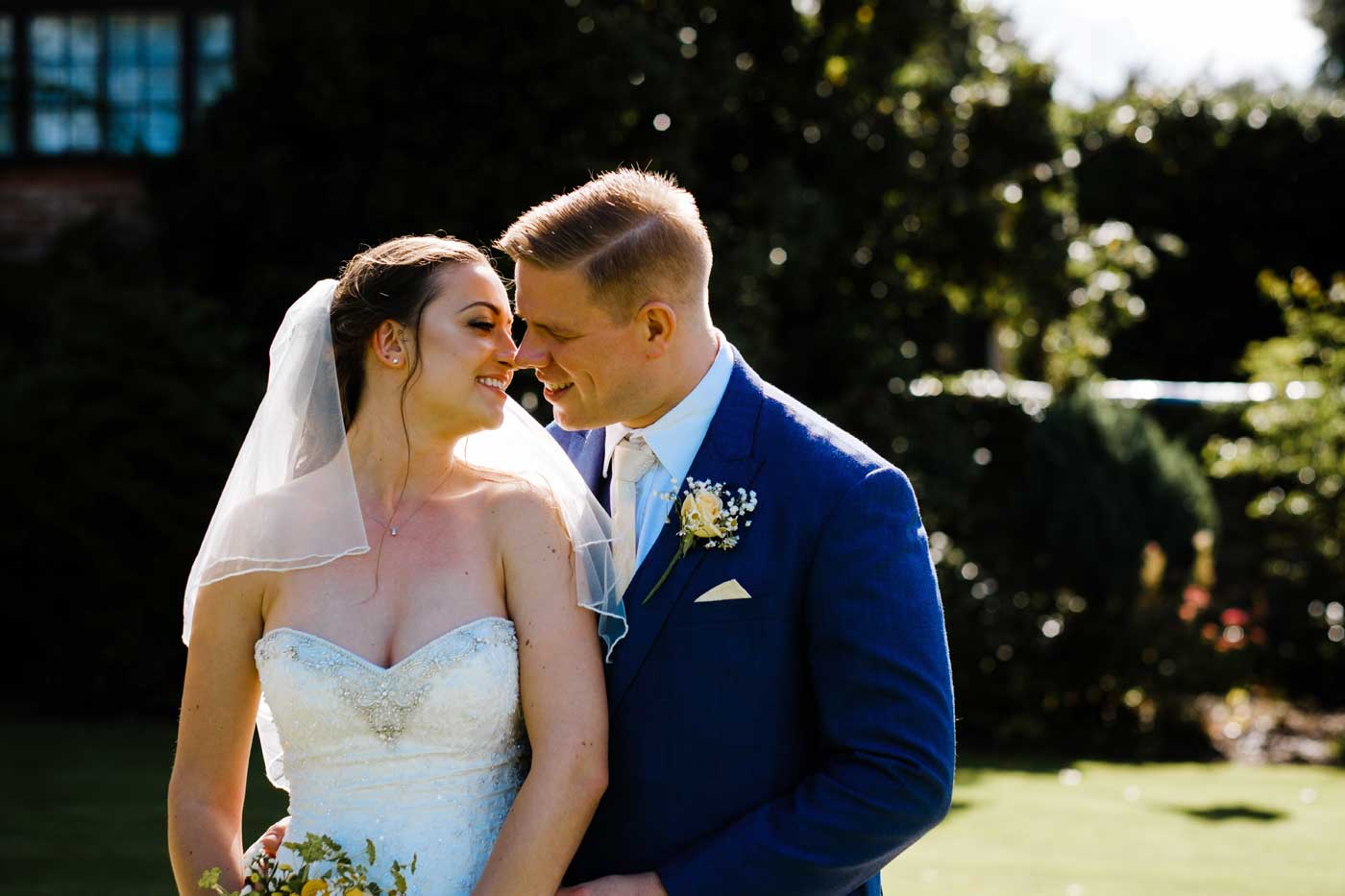 Bride and groom by Rowton Castle wedding photographer Clive Blair Photography