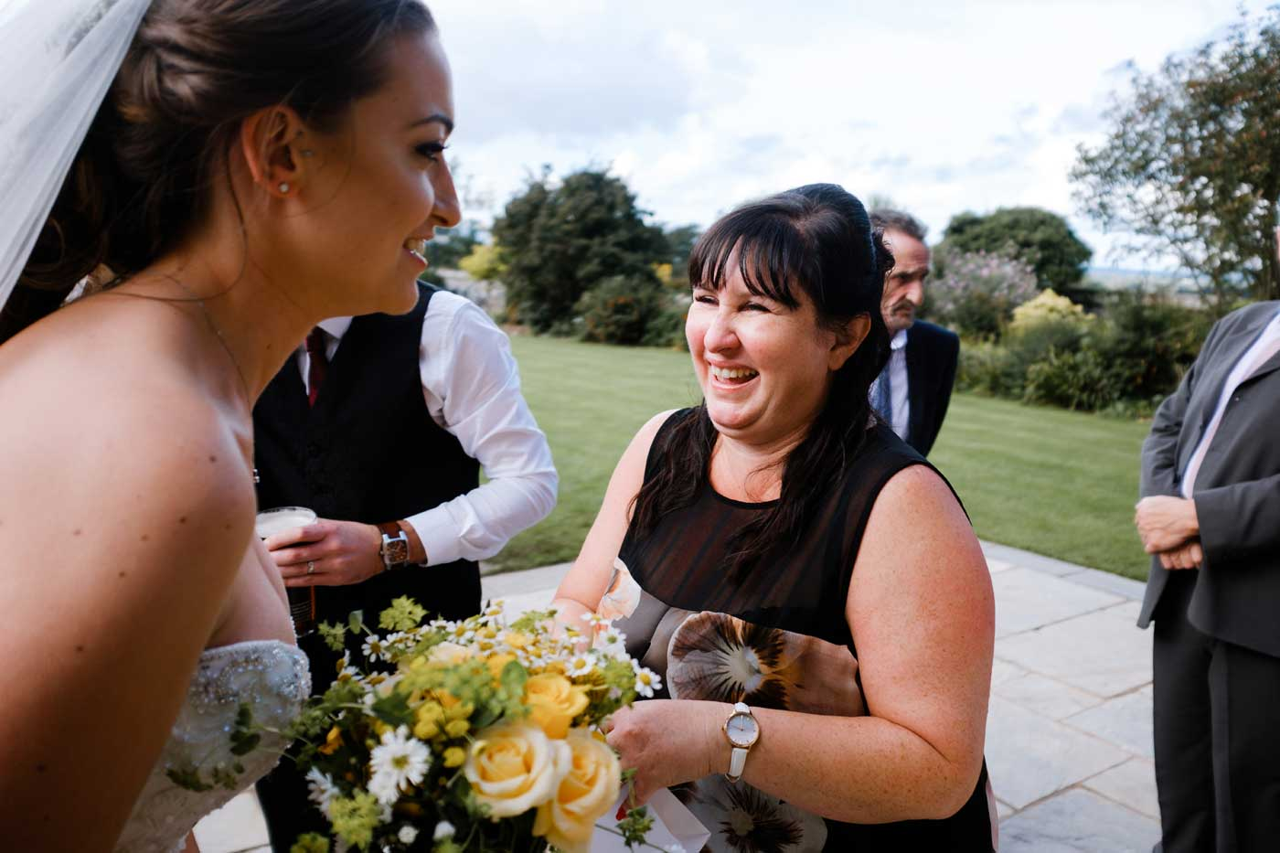 Bride laughing with woman guest at Rowton Castle