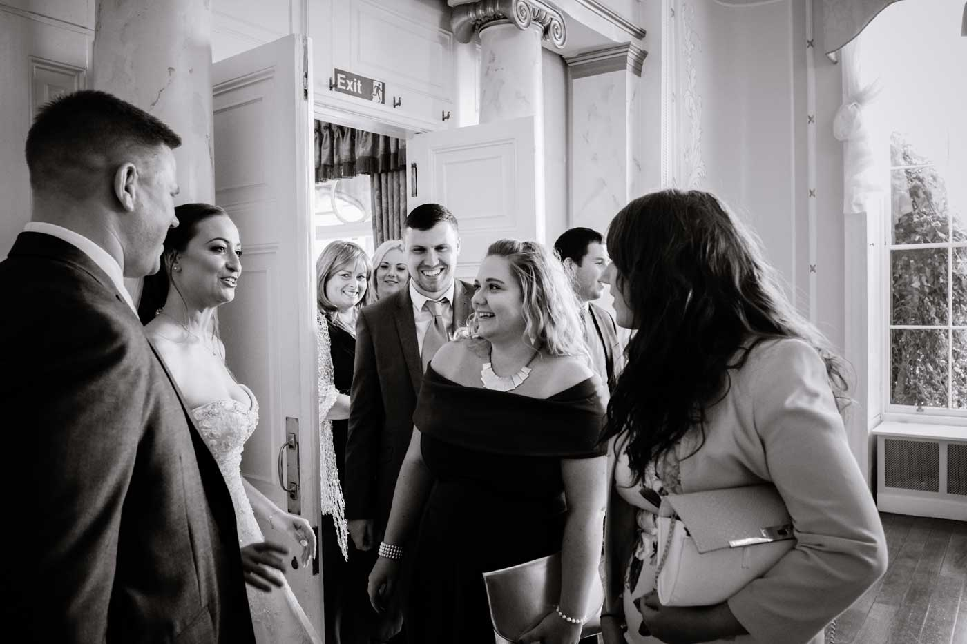 Bride and groom greeting guests at Rowton Castle