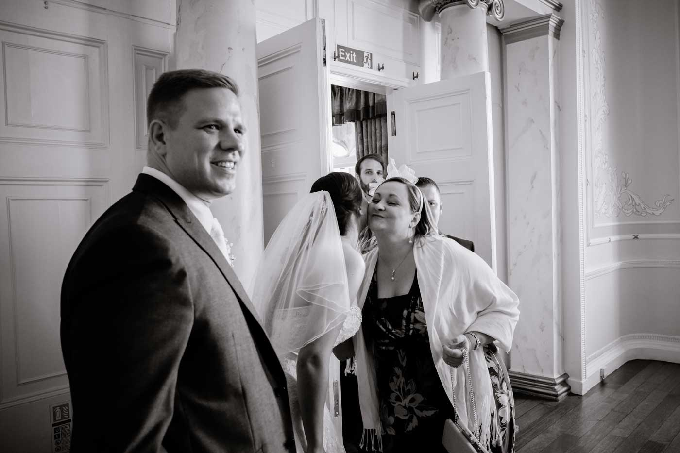 Woman greeting bride during receiving line at Rowton Castle