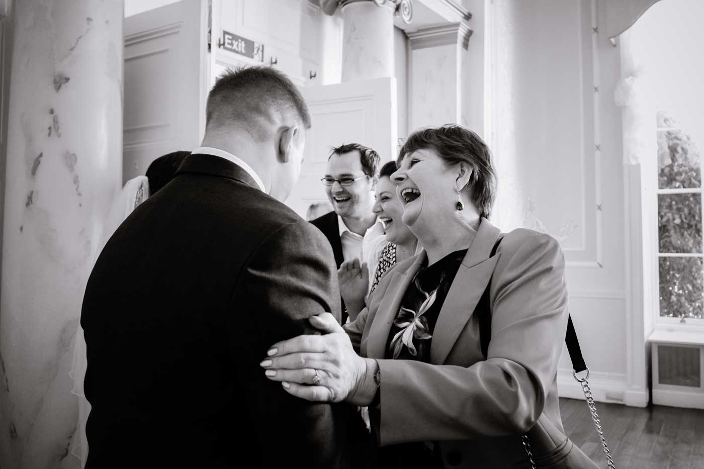 Woman shaking groom hand at Rowton Castle