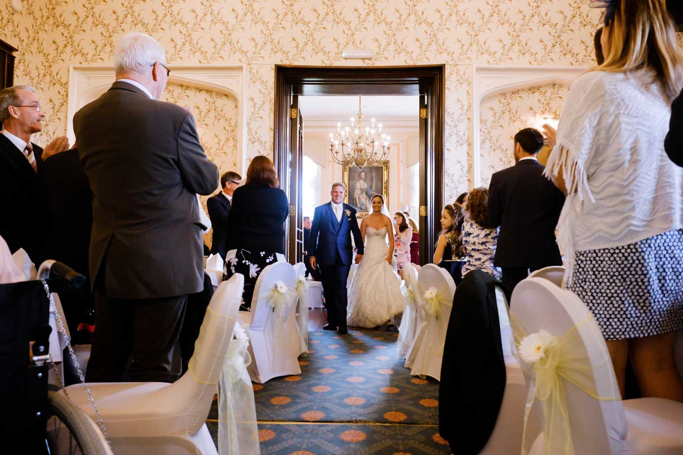 Bride and groom's entrance at Rowton Castle for their wedding breakfast