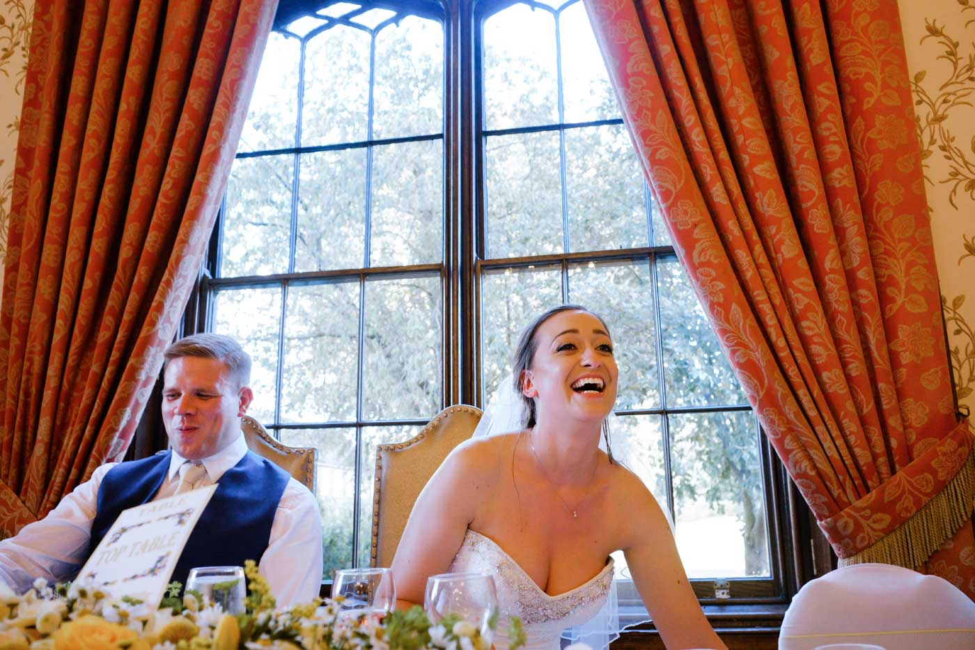 Bride laughing during speeches at Rowton Castle