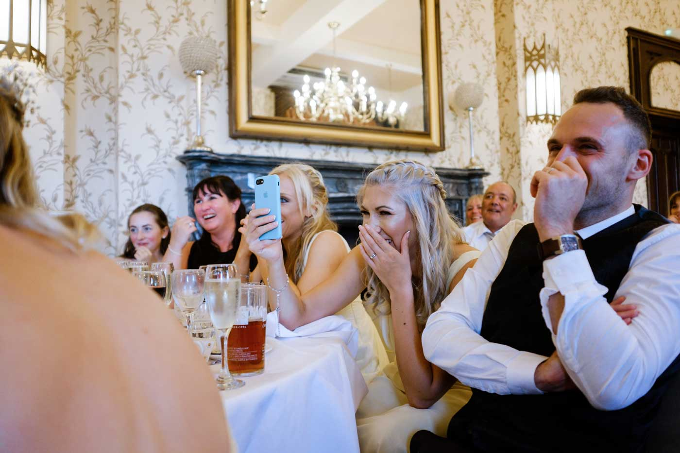 Guests laughing during the speeches at Rowton Castle