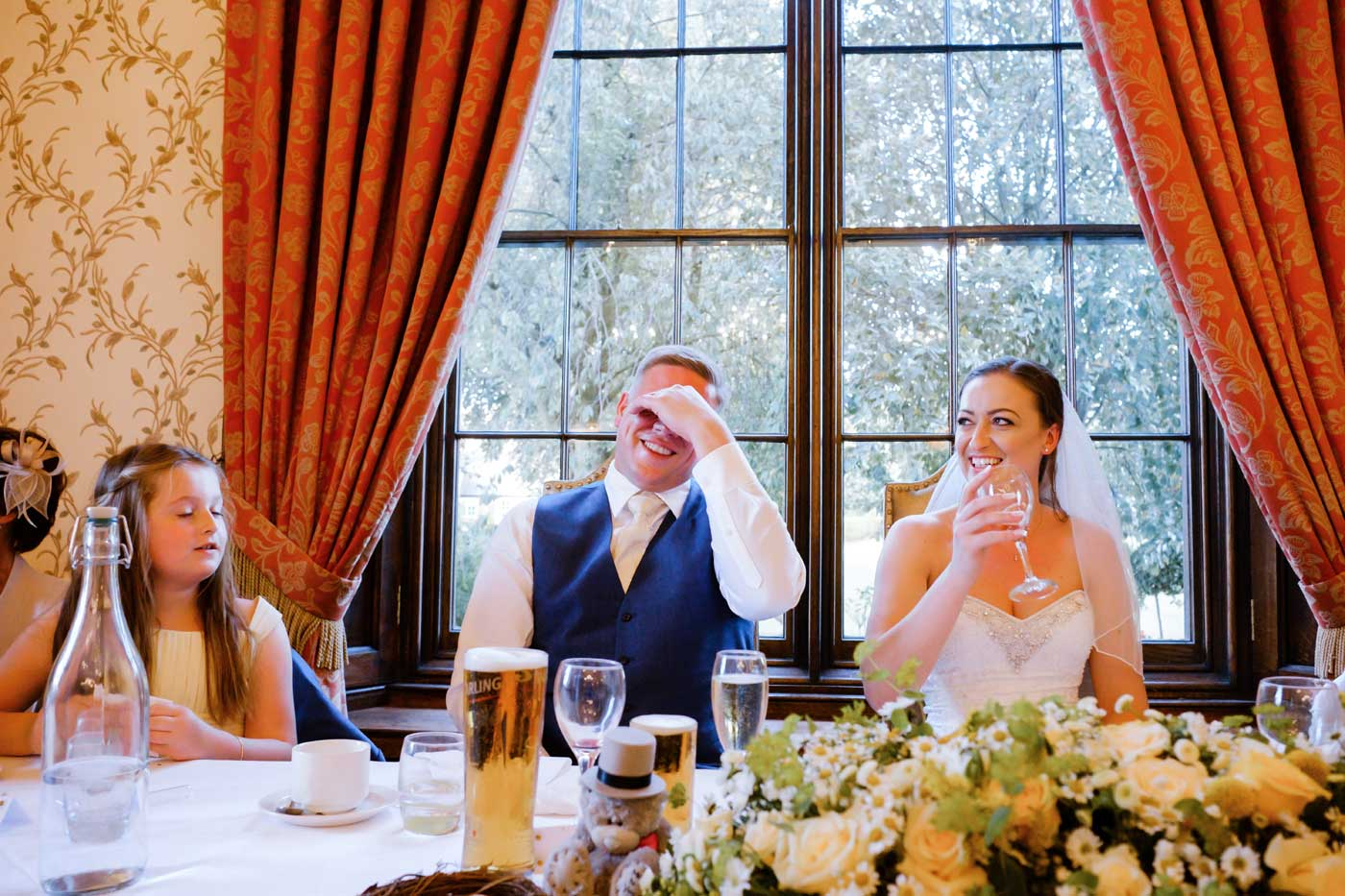 Embarrassed groom listening to bestman's speech at Rowton Castle