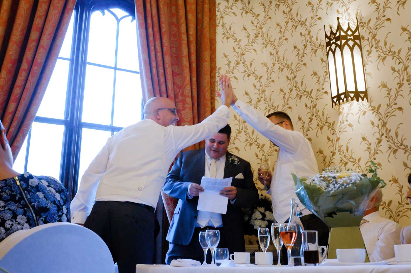 Best man giving usher a high five during his speech at Rowton Castle