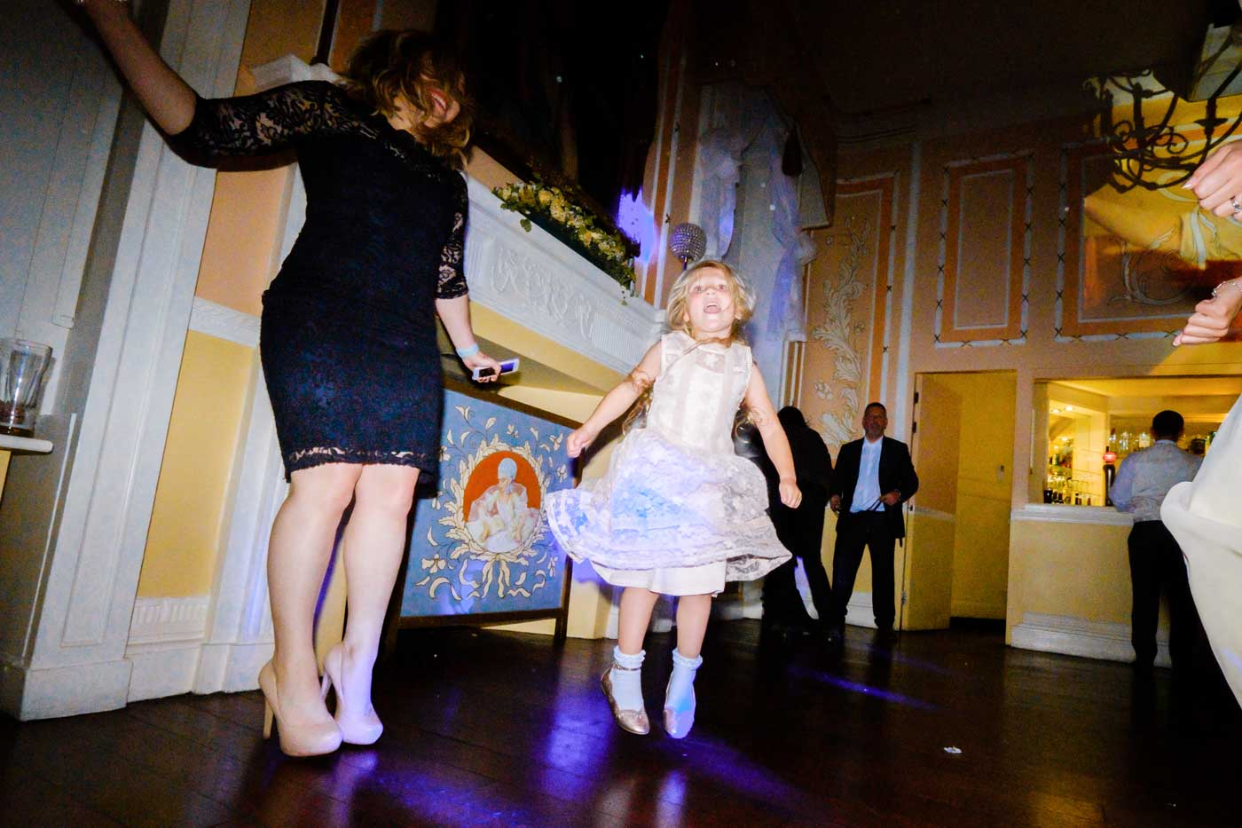 Woman and little girl dancing at Rowton Castle by documentary wedding photographer Clive Blair Photography