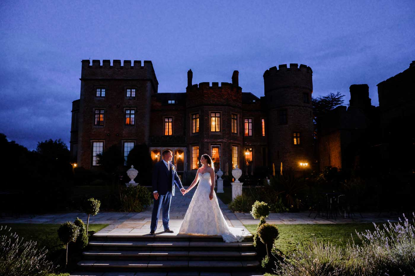 Backlight bride and groom during dusk in gardens of Rowton Castle by Birmingham documentary wedding photographer Clive Blair Photography