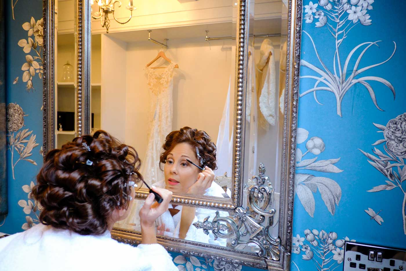 Bride getting ready at Stanbrook Abbey by Stanbrook Abbey wedding photographer Clive Blair Photography