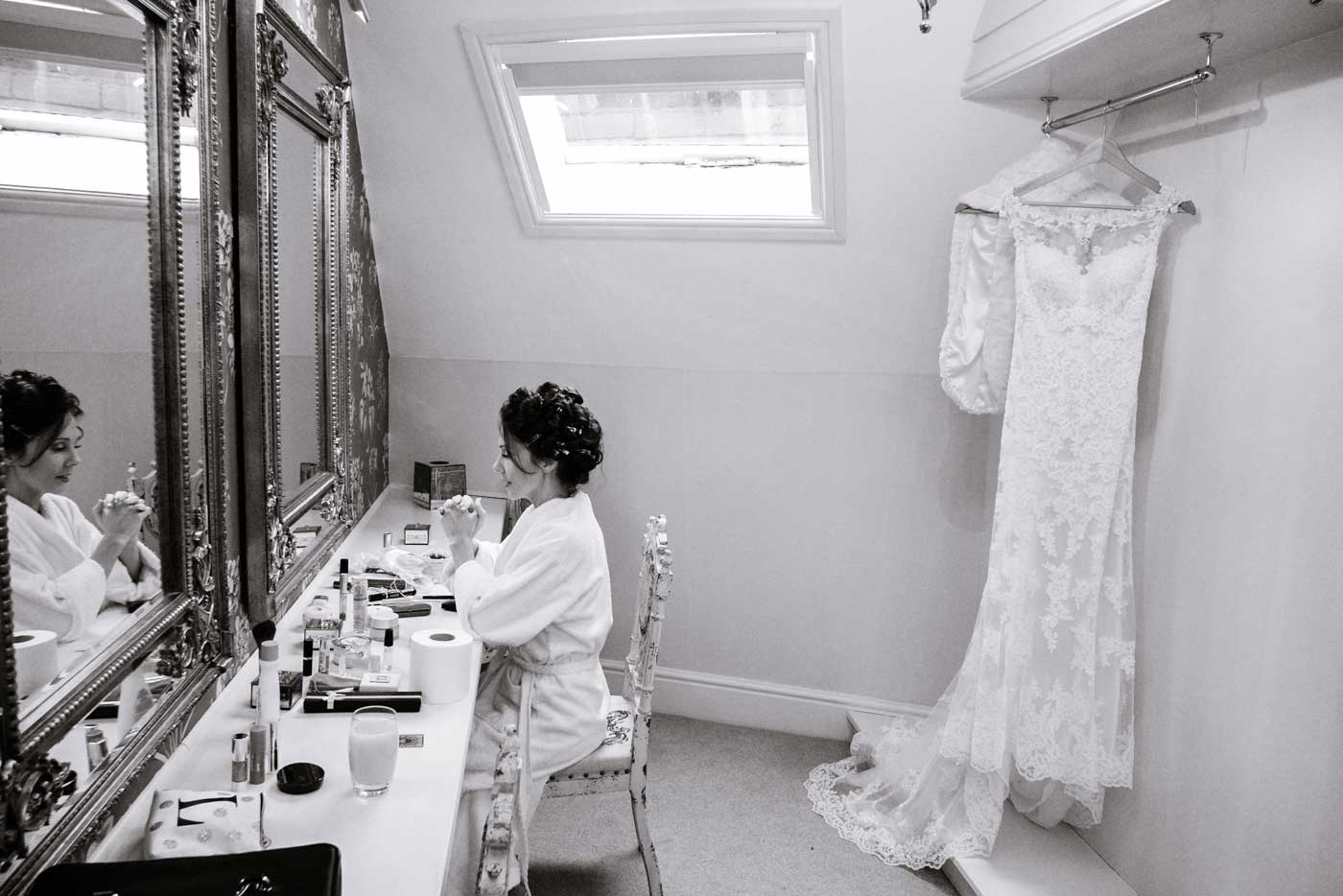 Pensive bride before her Stanbrook Abbey wedding