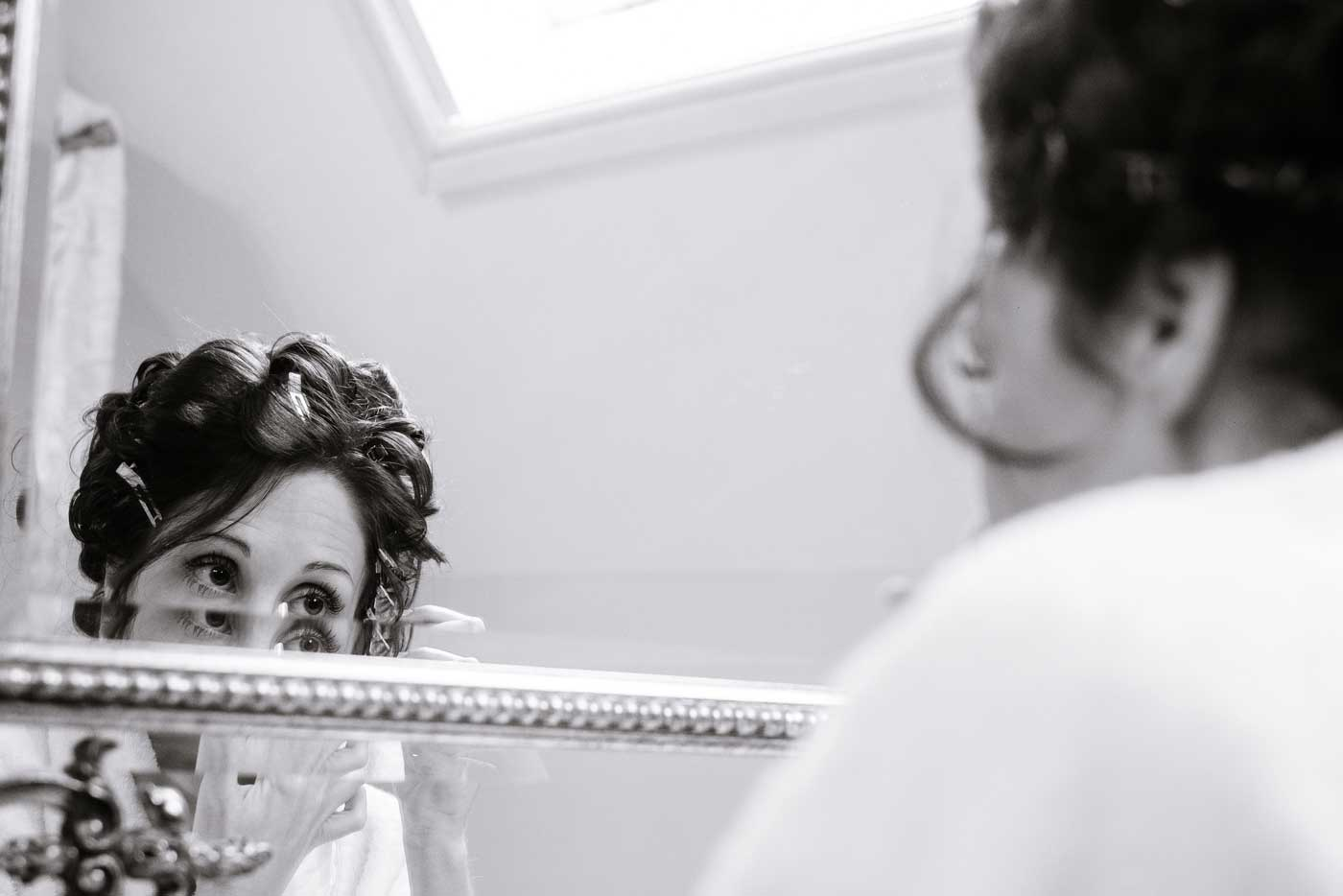 Bride applying makeup at Stanbrook Abbey