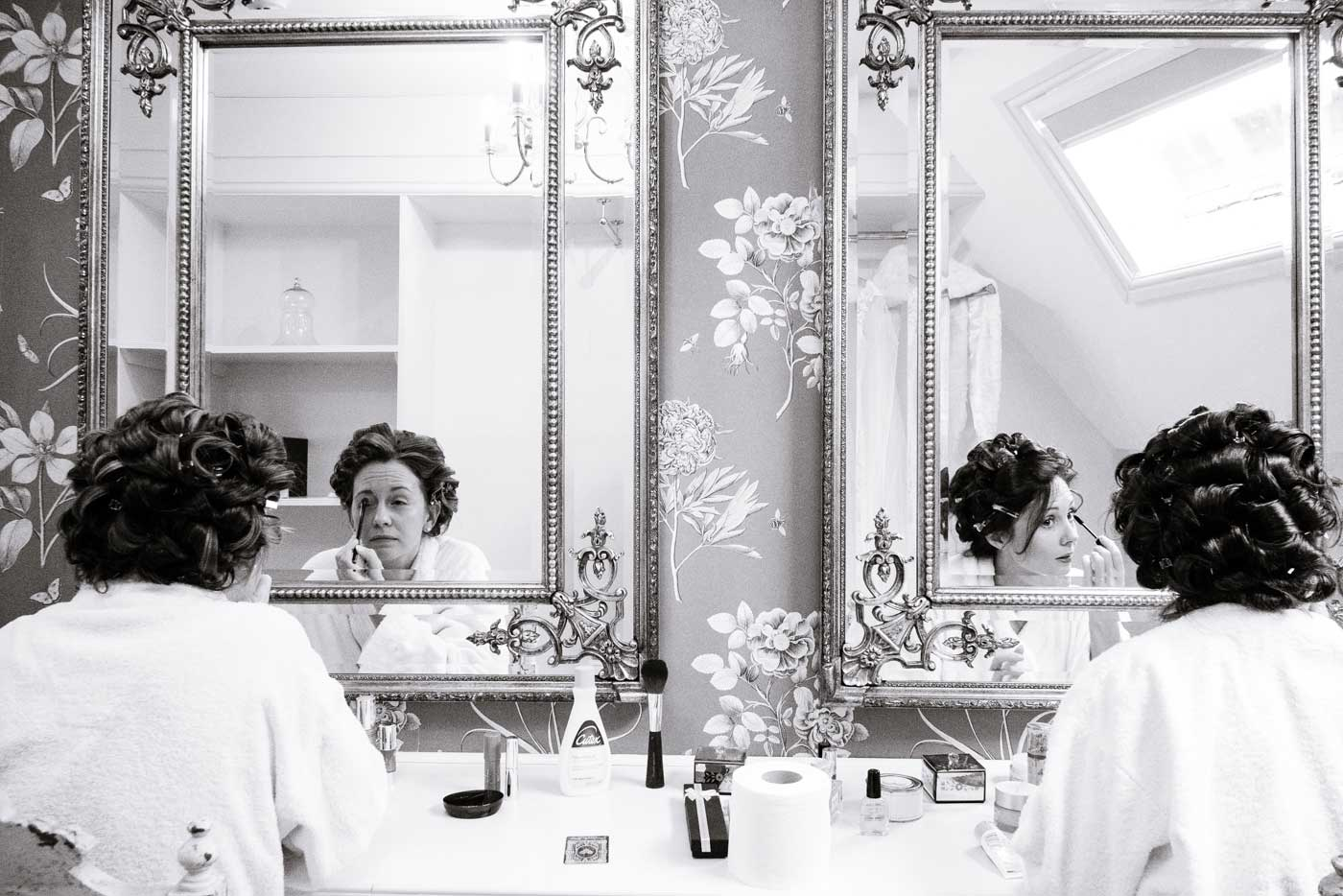Bride and maid getting ready at Stanbrook Abbey