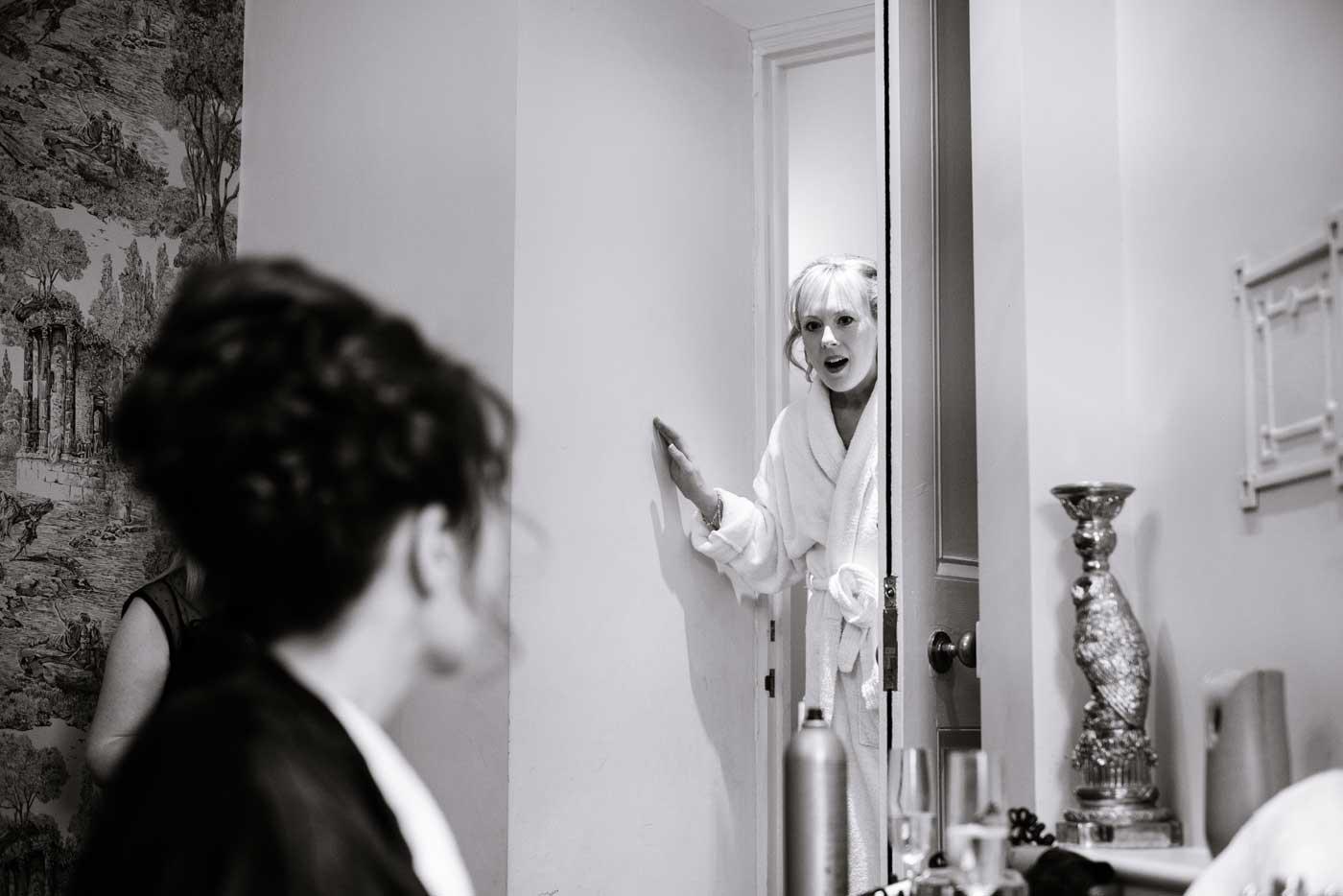 Surprised maid seeing bride