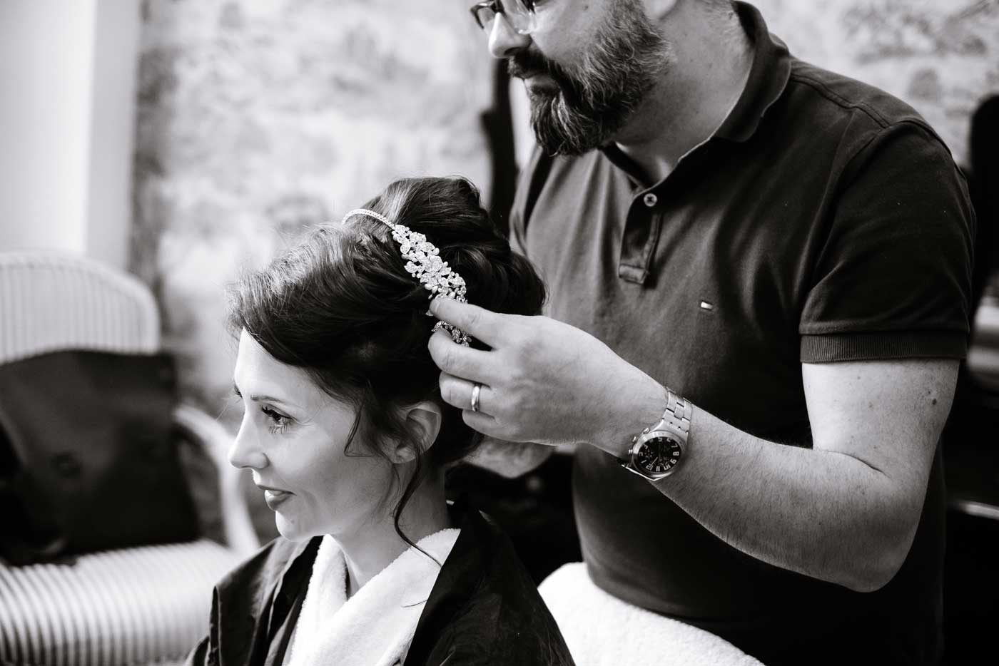 Bride having her tiara put on at Stanbrook Abbey