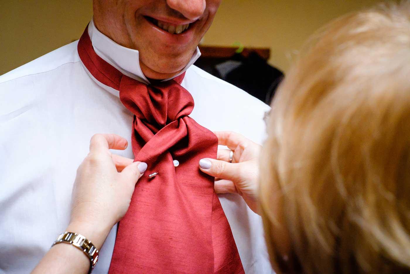 Close-up of groom's cravat