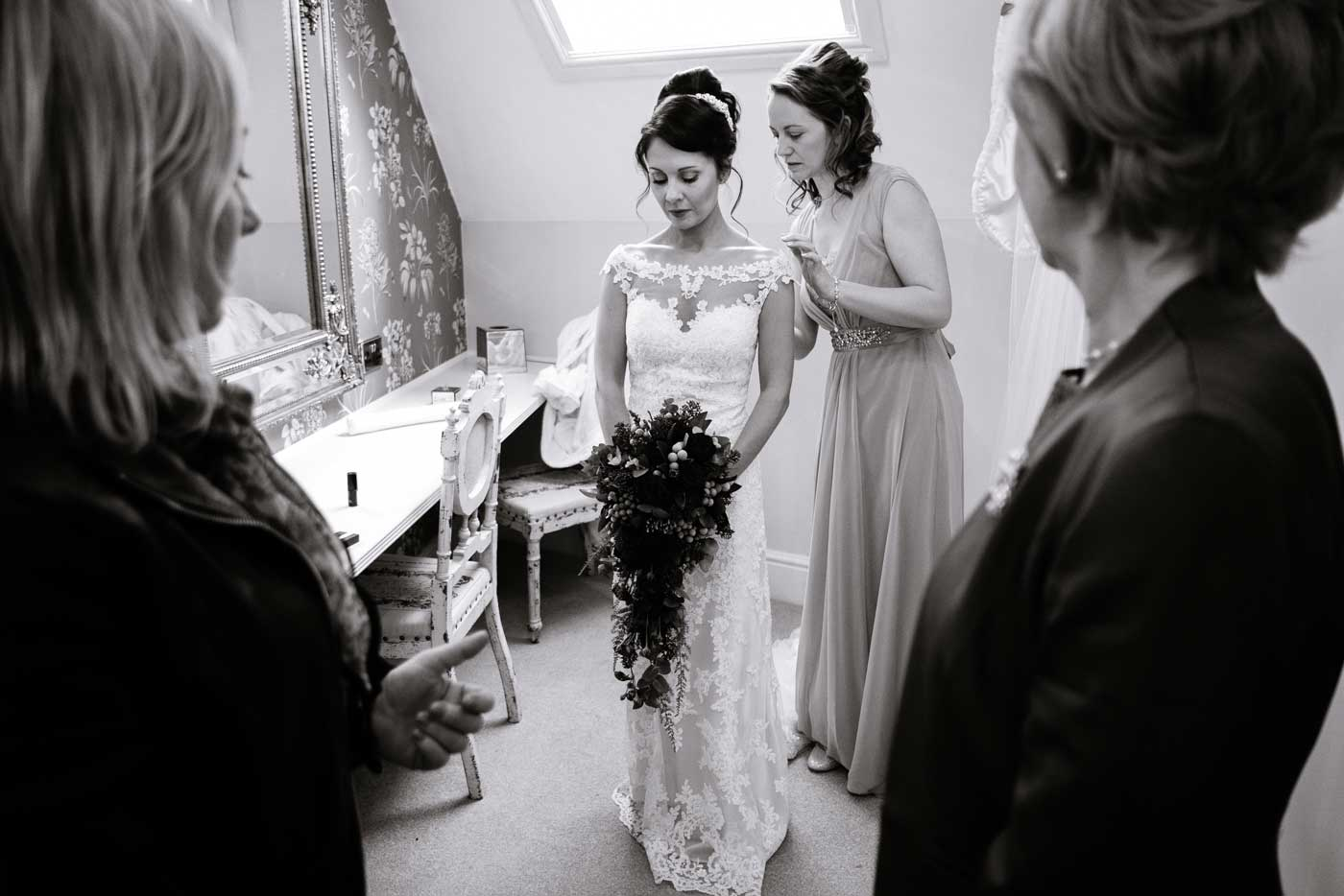 Pensive bride before her wedding by Stanbrook Abbey wedding photographer Clive Blair Photography