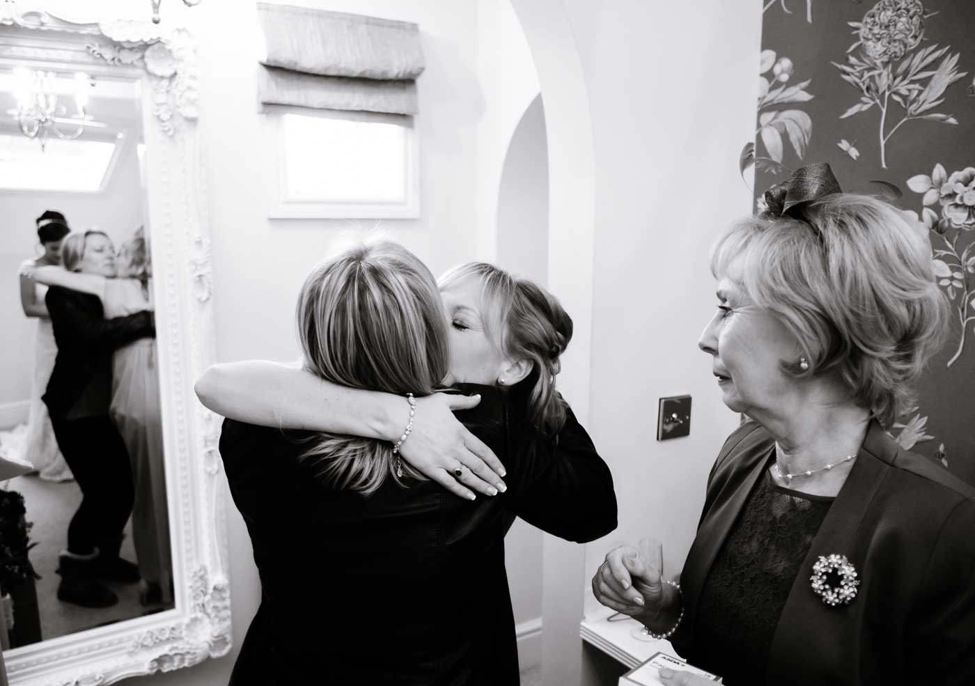 Women huggin at Stanbrook Abbey