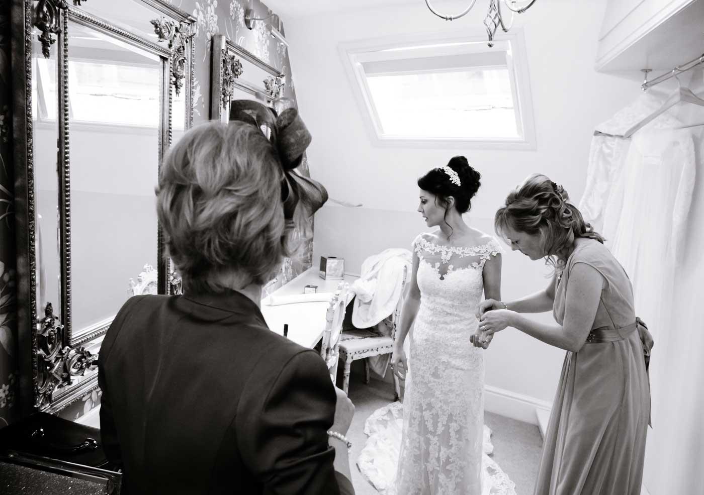 Bride being helped with bracelet